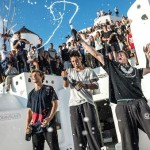 """Pavel Petkuns of Latvia, Dimitris Kyrsanidis of Greece (winner) and Jesse Peveril of Canada celebrate during the award ceremony of """"Red Bull Art of Motion"""" freeruning competition in Santorini Island, Greece on October 3, 2015."""